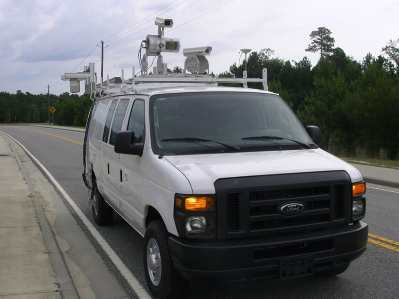 An image of a van with remote sensing equipment on the roof.