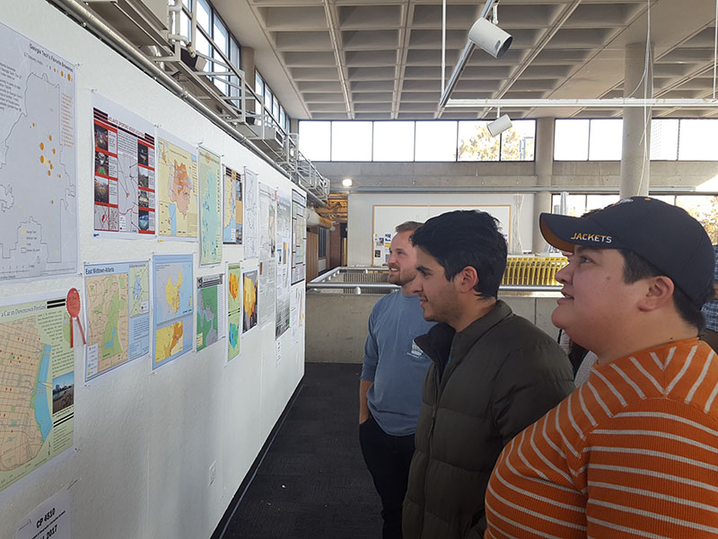 A photo of students looking at their work on display.