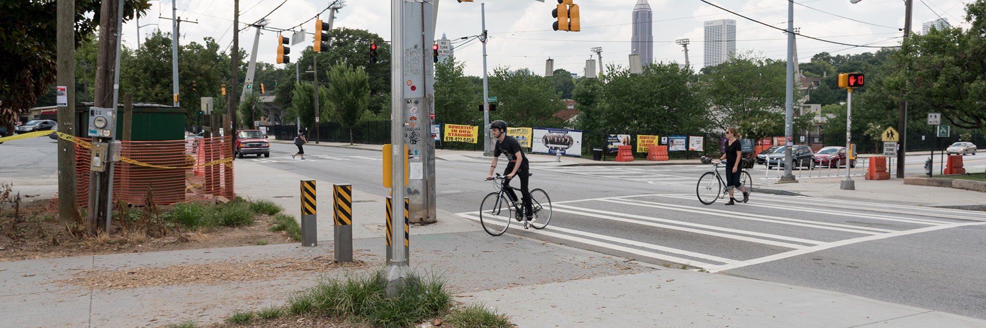 An image of cyclists crossing an urban intersection.